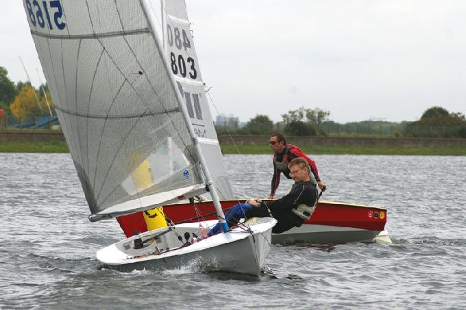 Third place Tim Lewis leads 2nd Place Godfrey Clark round the leeward mark at the Island Barn Reservoir Solo Open
