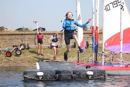 jumping in the water at sailing school
