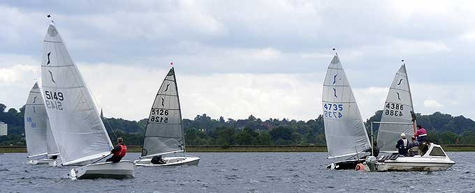 solo dinghy crossing the finishing line